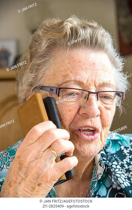 old woman with smartphone