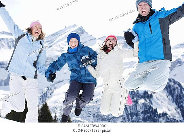 Family jumping on mountain top