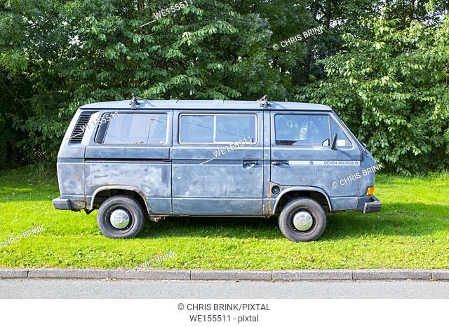 Old rusty VW Devon Microbus campervan parked in Cheshire, UK