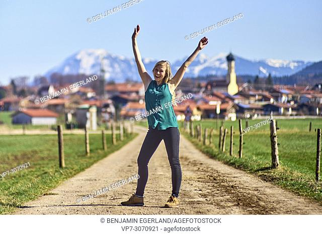 Lively woman at country side. Waakirchen, Bavaria, Germany