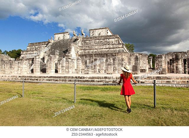 Woman posing at Chichen Itza Ruins near the Temple of the Warriors, Chichen Itza, Yucatan Province, Mexico, Central America