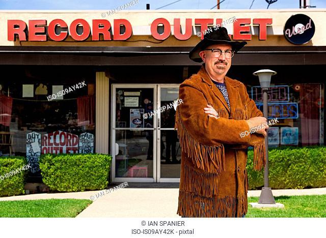 Portrait of mature man outside record shop