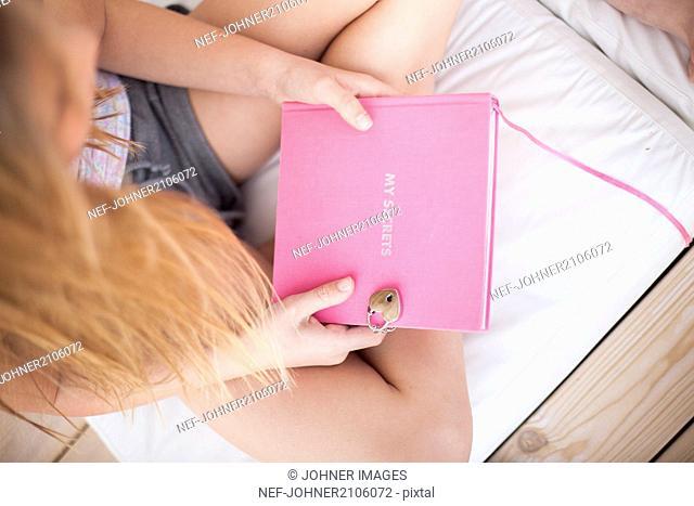 Girl holding diary