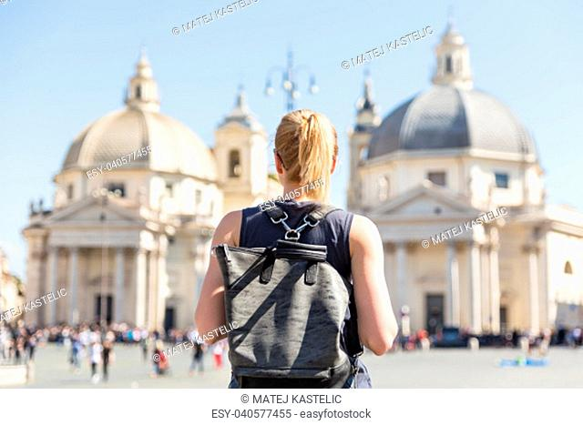 Female tourist with a fashinable vintage hipster backpack on Piazza del Popolo, People's Square, in Rome, Italy