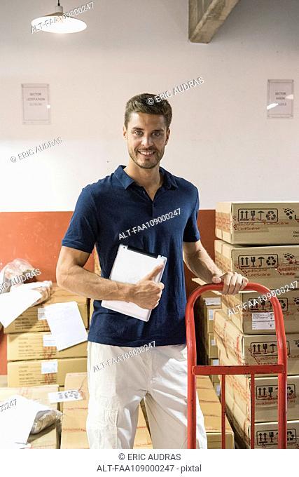 Man working in warehouse, portrait