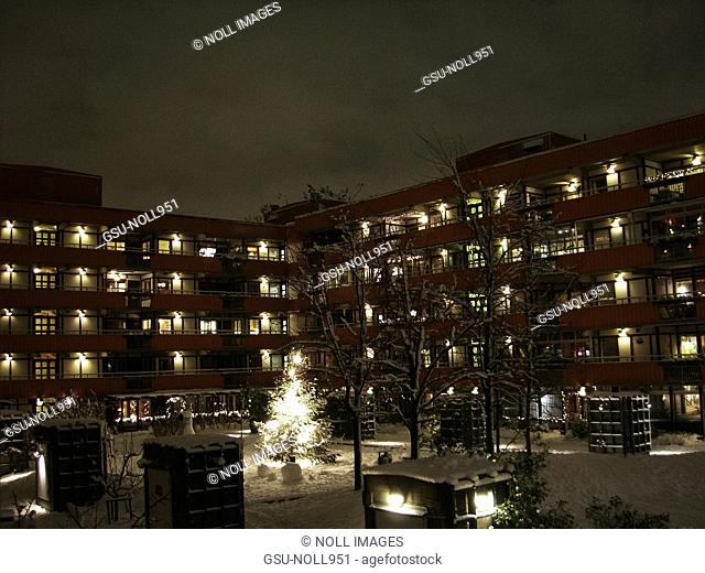Courtyard of Apartment Complex at Night During Snowy Winter