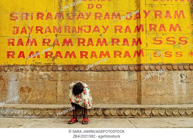 Man on the Ghats of Ganges river, Varanasi, Benares, Uttar Pradesh, India, Asia