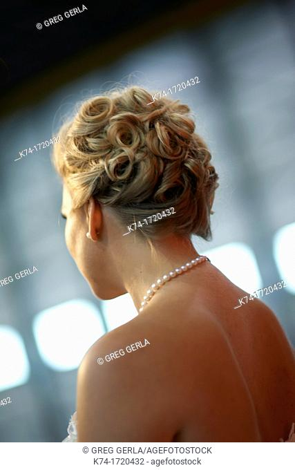 Photograph of a bride's back with pearl necklace
