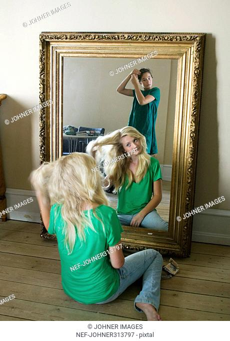 Teenge girls in front of a mirror