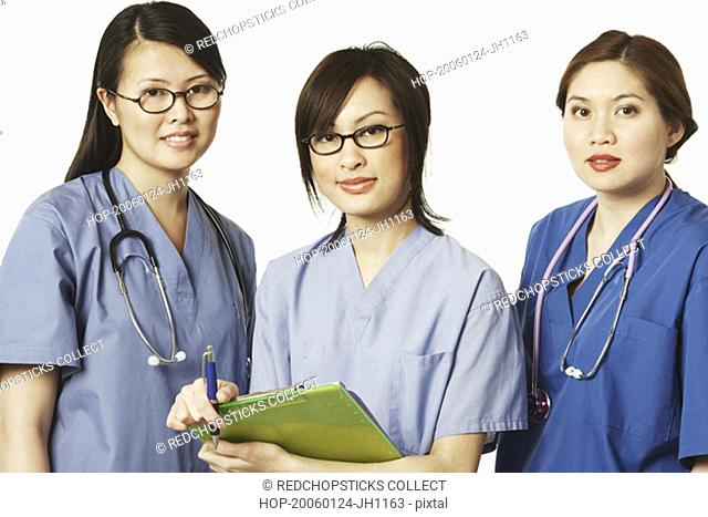 Portrait of three female doctors standing together