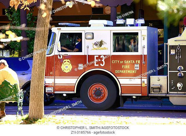 Fire truck of the Santa Fe Fire Department on E San Francisco Street near the Plaza in Santa Fe NM, USA