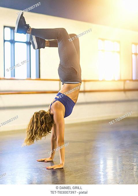 Young woman dancing in dance studio