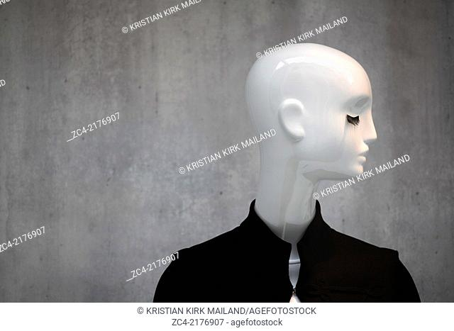 White mannequin with deep eyelash and black jacket