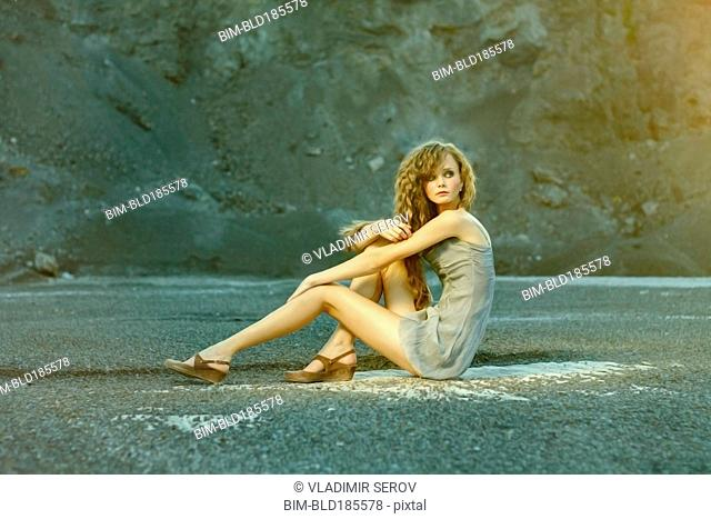 Caucasian woman sitting in quarry