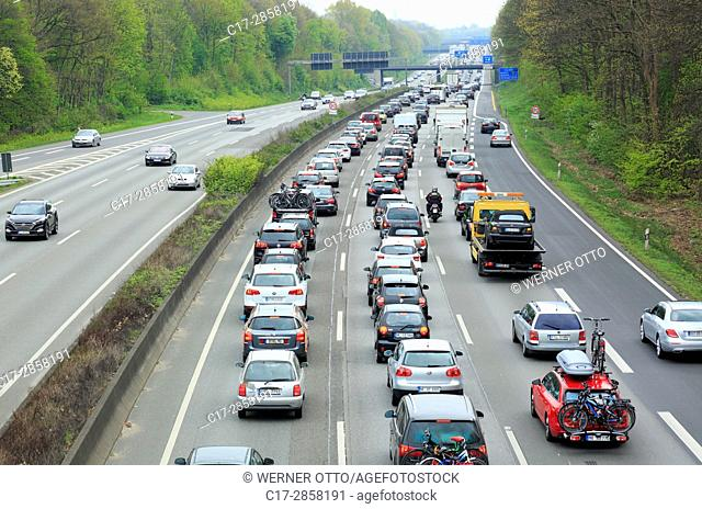 road traffic, motorway, traffic jam on the A2 at the Oberhausen motorway junction, Kreuz Oberhausen, automobiles, cars, motorcars, trucks, lorries, Oberhausen