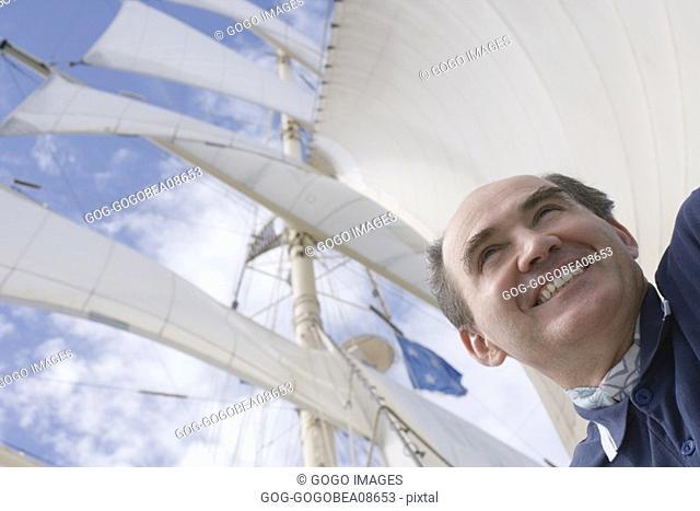 Man smiling on ship deck