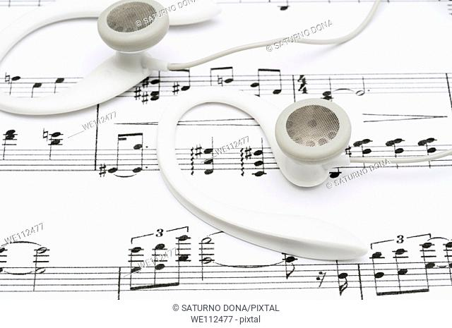 earphones on sheet music
