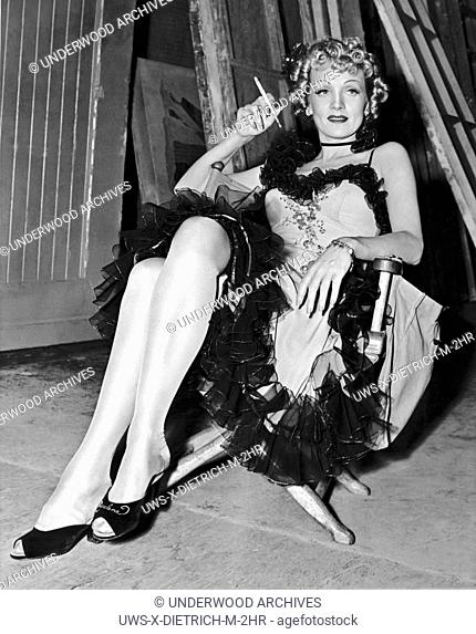 Hollywood, California: 1939.Actress Marlene Dietrich takes a cigarette break during the filming of Destry Rides Again