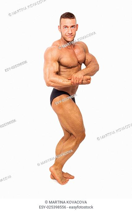 Sexy shirtless muscular bodybuilder posing isolated on white background. Sports and fitness