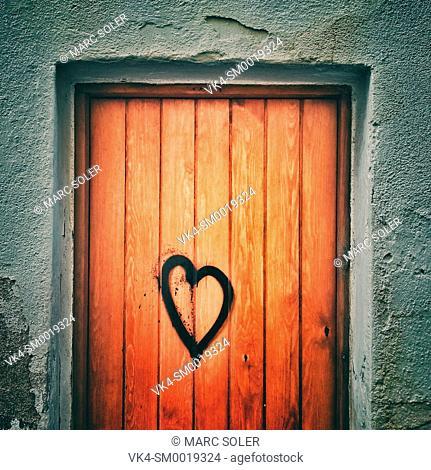 Drawn heart on a wooden door