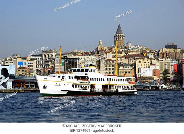 Harbor ferry at the Galata Bridge, Galata Koepruesue, on the Bosporus, Bogazici, with view on the Galata Tower in the Beyoglu district, Istanbul, Turkey