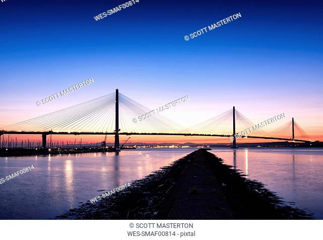 UK, Scotland, Fife, Edinburgh, Firth of Forth estuary, Queensferry Crossing Bridge at sunset