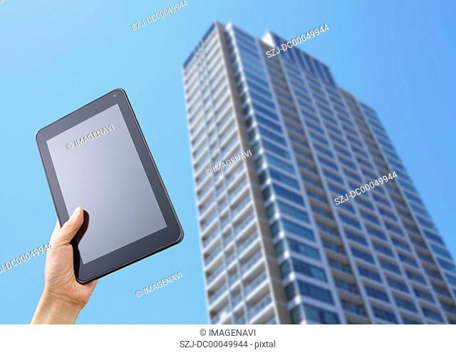 High-rise condominium and a tablet PC