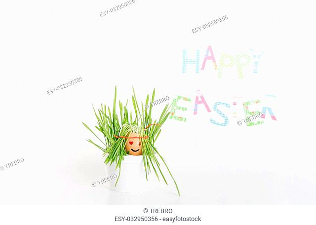 Easter decoration made of grass and egg-shell face with hair