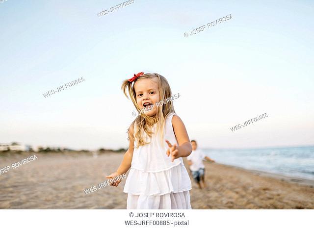 Portrait of little girl having fun on the beach