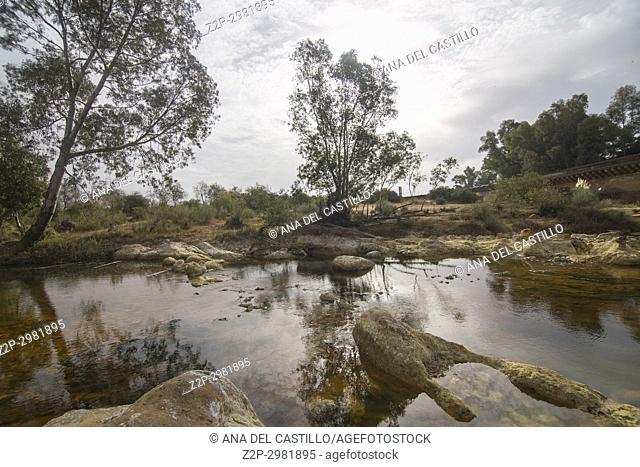 The river near the Roman bridge Rio Tinto in Niebla village Huelva province , Andalusia, Spain