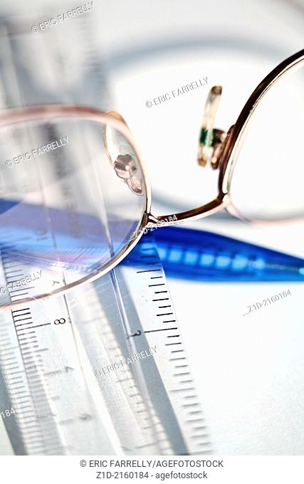 reading glasses,ruler and pen