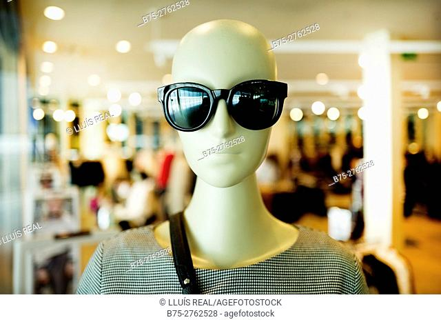 Mannequin with sunglasses in clothing store. Barcelona, Catalonia, Spain