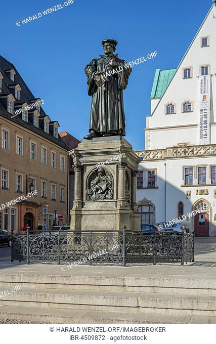 Luther Memorial, 1883, bronze statue, Luther Bible and excommunication, town square, Eisleben, Saxony-Anhalt, Germany