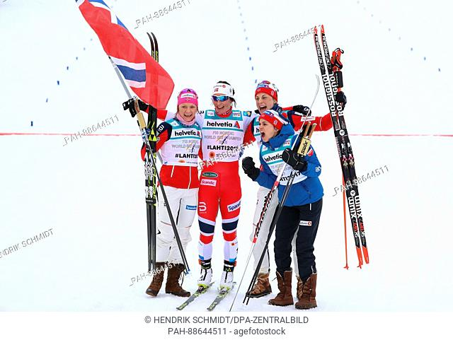 Maiken Caspersen Falla (l-r), Marit Bjoergen, Astrid Uhrenholdt Jacobsen and Heidi Weng from Norway celebrate after the women's 4x5 km cross-country relay event...
