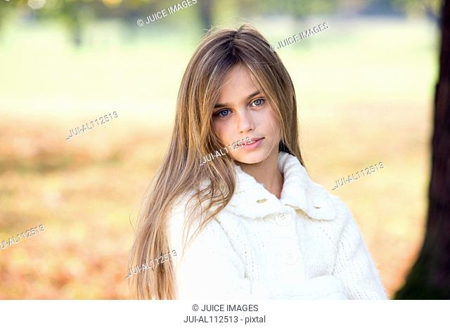 Portrait of girl in autumn forest