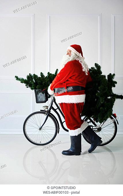 Santa Claus carrying with bicycle