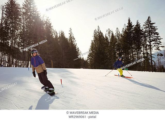 Couple skiing on snowy alps