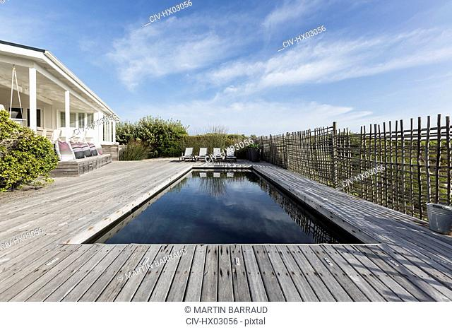 Tranquil home showcase swimming pool surrounded by wooden deck