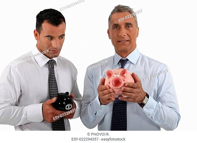 Two businessmen stood with piggy bank