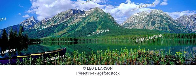 Canoe on Leigh Lake, Grand Teton National Park, Wyoming, USA