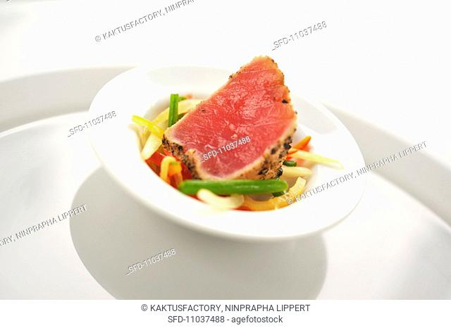 Tuna with black pepper and mixed vegetable salad