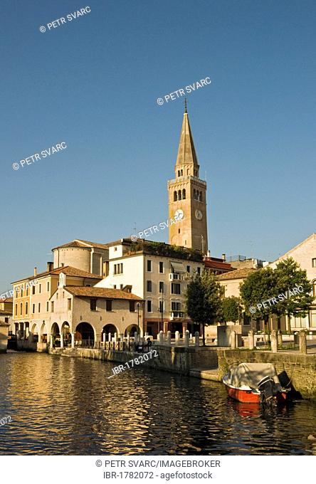 Historic district with leaning cathedral tower, Campanile pendente, and Lemene river, Portogruaro, Veneto, Italy, Europe