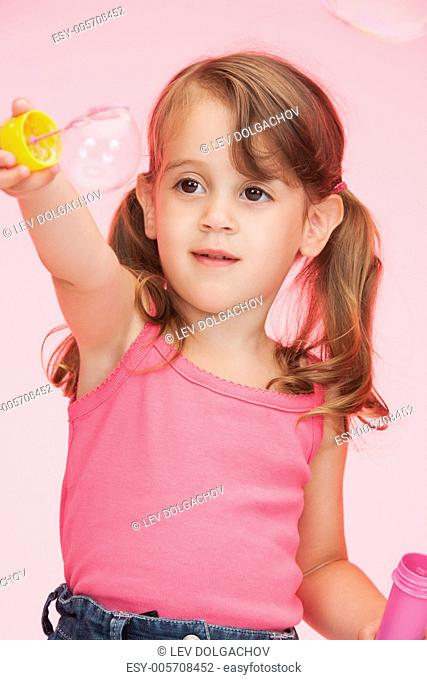 bright picture of beautiful litle girl with soap bubbles