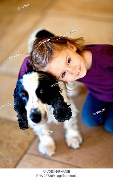 3 years old girl with her dog