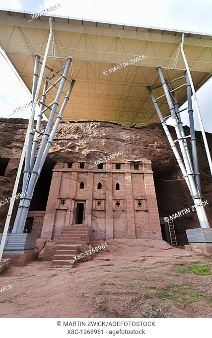 The rock-hewn churches of Lalibela in Ethiopia  Church Bet Abba Libanos,exterior  As a protection most of the churches are covered by a modern roofing  The...