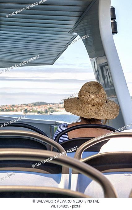 Woman on a ferry tour, Ria de Vigo, Pontevedra, Spain, europe