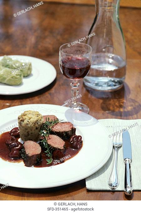 Loin of venison with cherry sauce and mushroom dumpling