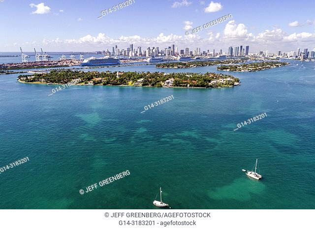 Florida, Miami Beach, Biscayne Bay, aerial overhead bird's eye view above, Star Island, Port of Miami cruise ships, city skyline, water, boats