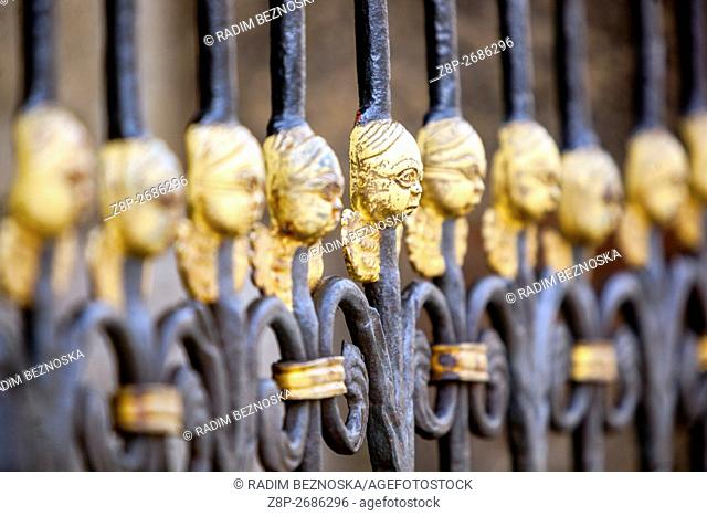 Gate of The Cathedral of St Bartholomew with cherubs for luck, Plzen, Czech Republic, Europe
