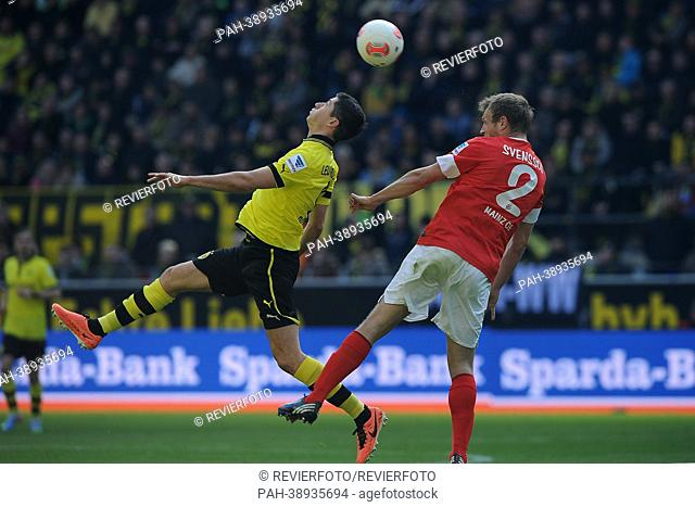 Dortmund's Robert Lewandowski (L) and Mainz player Bo Svensson vie for the ball during the Bundesliga soccer match between Borussia Dortmund and FSV Mainz 05 at...